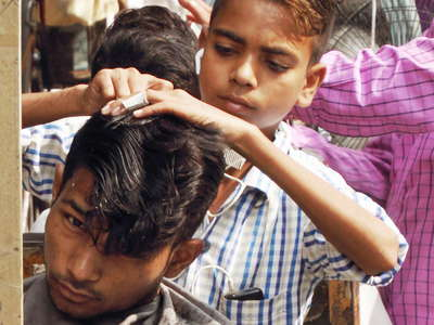 Delhi  |  Young barber at Chawri Bazar